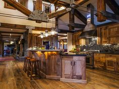 This mountain retreat, named Dream Catcher, is made of reclaimed woods and old railroad trusses. The stunning kitchen has state-of-the-art appliances, beautiful cabinetry, and a large island. Rate: $3,571/night   - HouseBeautiful.com