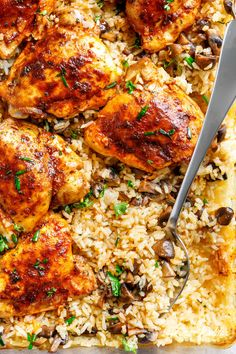 Easy Oven Baked Chicken And Rice With Garlic Butter Mushrooms mixed through is winner of a chicken dinner! Chicken thighs bake on top of buttery, garlicky, soft and tender rice with crispy edges. ALL the chicken flavours … Easy Oven Baked Chicken, Easy Chicken And Rice, Baked Chicken Recipes, Chicken Thighs In Oven, Chicken Rice Bake, Chicken Tights Recipes, Oven Baked Rice, Chicken Thigh Recipes Oven, Long Grain Rice And Chicken Recipe