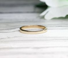2MM Simple gold wedding band.Promise ring.14K Solid gold Wedding Ring.Rose gold Plain Wedding band.Yellow gold Dainty wedding band. by LaBoutiqueByJulia on Etsy https://www.etsy.com/listing/556603155/2mm-simple-gold-wedding-bandpromise
