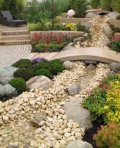Native landscaping, rock garden, water feature - ProudGreenHome.com