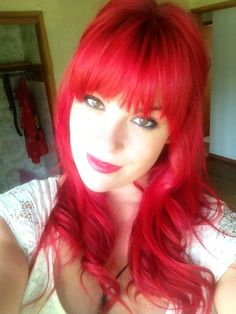 bright red curled hair with bangs....obsessed with red hair.