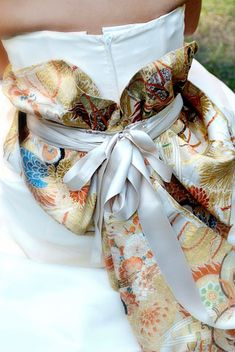 Japanese fabric got me started in the handbag business and this reminds me why....Japanese train on a wedding dress. Add a sash/belt/train in japanese fabric?