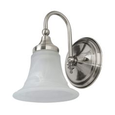 """Kinsely Single Bath Light=Shown in Brushed Nickel finish. Features a white marble glass shade. 7"""" L x 9"""" W (front to back) x 9-1/2"""" H.$9.95 - $13.95  Originally $13.95 - $18.95  •Accepts one 60-watt, medium base bulb. Backplate measurements: 6"""" diameter.  •6-1/2"""" top to outlet."""