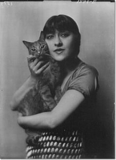 """Jenny Dolly, one of the Dolly Sisters, with Buzzer the Cat -----  """"It is told that at the age of four, when I was taken by the nurse to look at my newly arrived brother Hugo, I seriously remarked, 'I'd like a little kitten better.' I am fond of dogs, but cats have always meant more to me, and they have been the wise and sympathetic companions of many a solitary hour."""" - Arnold Genthe (Photographer) from """"As I Remember"""" (1936)"""