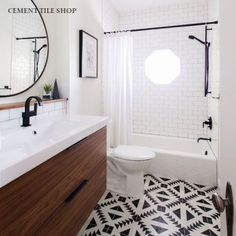 Dream bathroom. White subway tiles on walls and tulum in the gray and white for the floor, with the white kohler enameled cast iron shower basin and ikea vanity sink in the light oak.