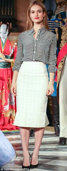 Chic:Lily looked chic in a black and white gingham shirt and white pencil skirt