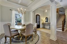 An elegant arch defines the dining room of this new home built by Elliott Homes in the Palmetto Pointe community. Ocean Springs, MS.