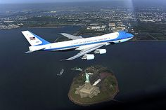 Air Force One over the Statue of Liberty