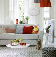 Inject a neutral palette with highlights of bold colour through the lighting and accessories. This way you can draw attention to key areas of the room – and ring the changes from season to season at a relatively low cost.    - housebeautiful.co.uk
