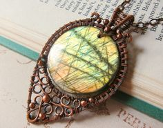 Sunspear  A magical Green Amber and Orange by SihayaDesigns, $140.00 I like the copper wirework!