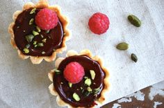 Tartlets with raspberry jam and chocolate ganache. I absolutely love them! <3 Recipe @ www.copenhagencakes.com