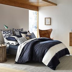 Bring Ellen DeGeneres' chic style to your bedroom with the urbane ED Ellen DeGeneres Bleu Duvet Cover. Inspired by Japanese aesthetic, the cool and casual bedding boasts an indigo ink wash with delicate pen lines and a bold ivory border with dyed edges.