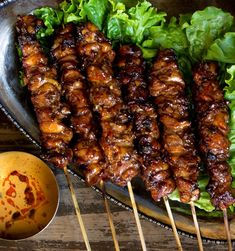 Smoky grilled chicken skewers recipe marinated in ginger, garlic, coconut cream and soy sauce. Then finished with a sweet coconut cream glaze and served with a simple peanut sauce. Big on flavor, super easy to throw together! Skewer Recipes, Entree Recipes, Grilling Recipes, Asian Recipes, Vegetarian Grilling, Healthy Grilling, Kraft Recipes, Barbecue Recipes, Barbecue Sauce