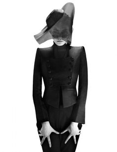 black outfit with futuristic hat with incorporated veil