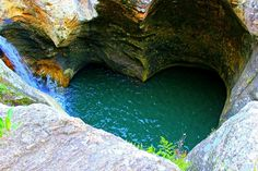 Where is it: Lot 2 Beechmont Rd, Beechmont QLD           Why we love it: It's a beautiful rocky creek and waterfall that has carved a heart shaped waterhole!       Tell me more: <NOTE: Generally open on weekends, access to the creek is currently off limit