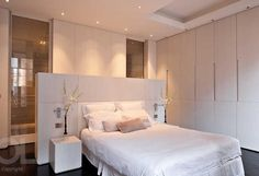 clean simple contemporary bedroom suite with ensuite shower room set behind the bed and banks of fabulous wardrobes to one side. Great lighting too! Hélène et Olivier Lempereur - Architecte décorateur Bedroom Divider, Bedroom Decor, Bedroom Ideas, Contemporary Bedroom, Modern Bedroom, Contemporary Kitchens, White Bedroom, Master Bedroom, White Headboard