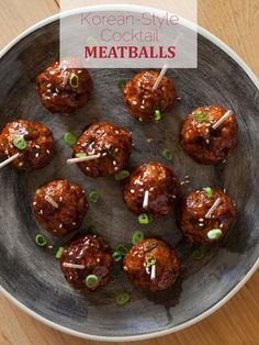 Cocktail meatballs with a Korean chili sauce, topped with green onions.