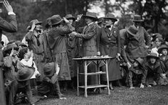 Daisy observing as Grace Coolidge hands out awards to Girl Scouts in 1925. Girl Scouts of the USA—Juliette Gordon Low Birthplace. Used by Permission