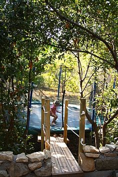Kids trampoline to burn some energy on – or just hide on at the bottom of t… - Playground Garden İdeas Trampolines, Garden Trampoline, 14ft Trampoline, Trampoline Ideas, Rio Ranch, Outdoor Playground, Front Yard Landscaping, Privacy Landscaping, Woodworking Projects Plans