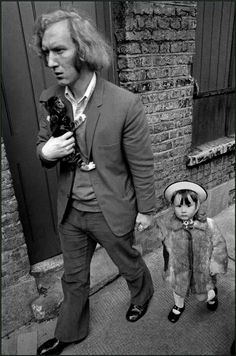 Ian Berry  Europe. England. London. Whitechapel. Man with his daughter and kitten in London's East End.