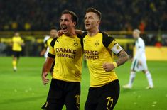 DORTMUND, GERMANY - DECEMBER 21:  Marco Reus of Borussia Dortmund (r) celebrates scoring his side's second goal with Mario Gotze of Borussia Dortmund during the Bundesliga match between Borussia Dortmund and Borussia Moenchengladbach at Signal Iduna Park on December 21, 2018 in Dortmund, Germany. (Photo by Lars Baron/Bongarts/Getty Images)