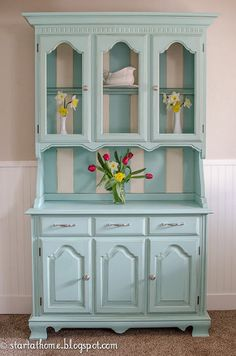 Light coastal blue color on painted hutch - LOVE IT.