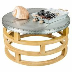 "Metal-topped coffee table with a wood latticework base.  Product: Coffee tableConstruction Material: Wood and metalColor: Silver and naturalDimensions: 16"" H x 30"" DiameterNote: Accents pictured are not included"