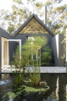 You'd be forgiven for imagining yourself in Bali as you enter Maison Noir across the wooden boardwalk straddling two ponds filled with koi. Classic House, Modern Classic, Source Of Inspiration, Design Inspiration, Pine Forest, Garden Features, Cabin Fever, Rental Property, Water Garden