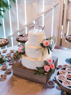 Three tier rustic deer topped wedding cake: http://www.stylemepretty.com/little-black-book-blog/2017/01/27/rustic-romantic-georgia-winter-wedding/ Photography: Simply Sarah - http://simplysarah.me/