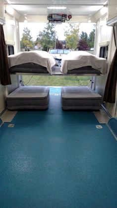4 Twin Beds with Happy Jack Lift Bed in Toy Hauler