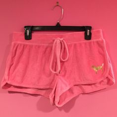 PINK Victoria's Secret shorts Price reflects condition, minor hole in the back. Can be worn over a bathing suit or patched to cover the hole. PINK Victoria's Secret Shorts