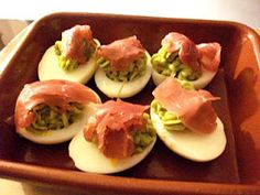 Deviled Eggs will avocado, hot sauce, lemon juice..salt pepper..then put smoked beef on top...i think procuitto would be good...