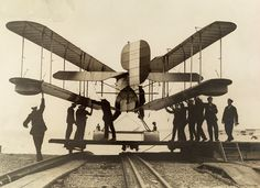 Men inspect a British airplane with folding wings, 1918. No Credit Given. National Geographic