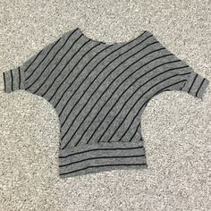 Boutique Dolman sweater with 3/4 sleeve Darling dolman sweater top with 3/4 sleeve. So cute. So comfortable. Very stretchy. Size medium. Grey with black stripes. Gently used no signs of wear. Purchased from Bohme boutique. Extremely flattering fit. Teenbell Tops Blouses