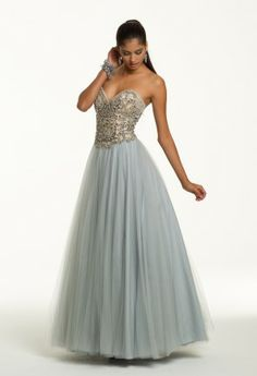Be a dreamlike vision in this picturesque long strapless dress. Surrounded by delicate tulle and elaborate beading, this ball gown was made for a magical night and is ideal for Prom 2014. From the feminine sweetheart neckline down to the two-toned full skirt this dress creates the perfect princess look that every young lady dreams of! Sparkle the night away and prepare to leave onlookers breathless in this stunning prom dress. Complement this charming dress with sweet oval dangle earrings…