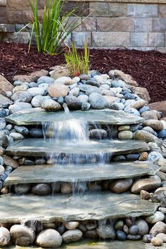 76 Backyard and Garden Waterfall Ideas I love the pondless waterfall features due to their simplicity and ease of setup and design. Pavers of all shapes and sizes are fun to shop for and choose based on your color and textual preferences. Outdoor Water Features, Water Features In The Garden, Backyard Water Feature, Ponds Backyard, Backyard Waterfalls, Backyard Patio, Koi Ponds, Paved Backyard Ideas, Outdoor Fish Ponds