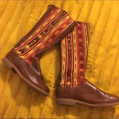 ⚠️SALE⚠️ Reef leather Navajo tribal print boots If you know Reef, you know you'll love these!  The leather is perfectly distressed and the durable canvas fabric has a super cool yellow and red Aztec print. These knee-high flat boots zip up the back. I'm going to guess they run a little small and would certainly fit a size 9 1/2, or even a 9 if worn with very chunky socks. Reef Shoes