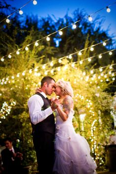 beautiful wedding lights ... use a guide wire with the string lights to prevent drooping. Looks like these might be C9 string lights: http://www.partylights.com/Strings-Bulbs/C9-Strings-Bulbs