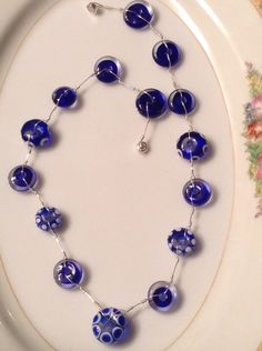 Sterling silver necklace with cobalt blue and white lampwork beads handcrafted by Blueberry Bay Beads