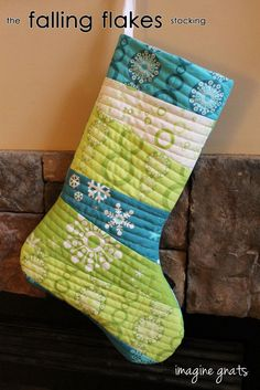 Free tutorial and pattern for a simple and fun quilt as you go stocking, the falling flakes stocking.