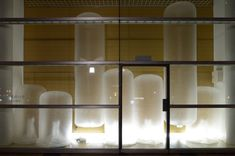 onishi yasuaki inflates plastic volumes for granship window in japanjapanese artist . for the window of shizuoka convention & arts center 'granship' in japan, he has created 'vertical volume', an amassed arrangement of hovering white objects which buoyantly float up-and-down. the air bag-like pouches are made from thin sheets of plastic, while a simple fan sits beneath, allowing them to easily sway around the room.
