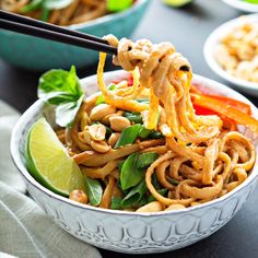 A quick 20 minute Spicy Peanut Noodles recipe with a spicy homemade peanut sauce that is tossed over noodles and topped with peanuts, green onions and lime. If you are a Thai takeout lover like Peanut Recipes, Spicy Recipes, Asian Recipes, Vegetarian Recipes, Cooking Recipes, Healthy Recipes, Chicken Recipes, Spicy Peanut Noodles, Spicy Asian Noodles