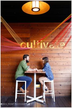 Engagement photos at Anaheim Packing House patio, barstools, cultivate sign ©Asea Tremp Photography 2014