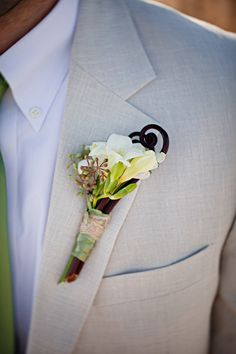 Boutonniere designed by celestinesweddings.com, Photography by pure7studios.com