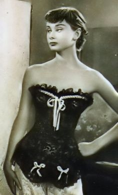 Gorgeous Audrey Hepburn sporting a corset in the movie Monte Carlo Baby.