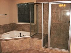 Luxurious Master Bath with corner garden tub and built-in hand crafted ceramic master shower with bench. Corner Bathtub Shower, Corner Jetted Tub, Corner Tub, Shower Tub, Small Master Bath, Master Shower, Master Bathroom, Bathroom Tubs, Bath Tub