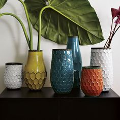 """I pinned this one because I am decorating for a client who does not want a lot of """"stuff"""" hanging around.  Whatever I choose, I'm striving for pretty and functional...these fit the bill!  votive or candle holder or vase (let the client pick!) just the right pop of colour!  I pick the short, orange From West Elm """"Hive Vases""""  http://www.westelm.com/products/hive-vases-c046"""