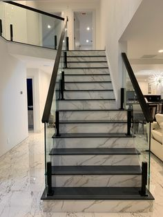 Glass railing for a marble staircase - - Staircase Design Modern, Luxury Staircase, Home Stairs Design, Marble Staircase, Stair Railing Design, Stair Decor, Staircase Railings, Balcony Design, Staircase Ideas