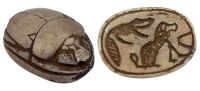 """Carved beige limestone scarab with a baboon and an alligator.18th Dynasty.  Size: ¾""""  Date: 1570-1342 BC"""