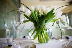 White tulip wedding centerpiece and greenery in a bubble bowl / budget wedding / cheap ideas. DIY wedding flowers.